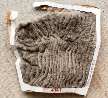vac air conditioning filter clogged with dust and dirt and falling to pieces after not being changed frequently